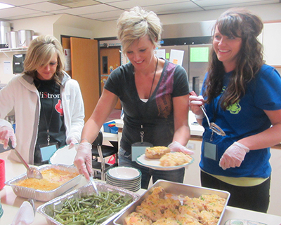A team of volunteers serves a hot, tasty meal!